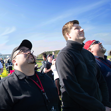 People watch a space launch